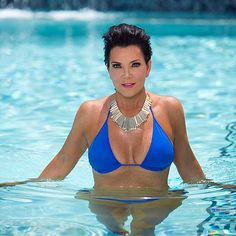 Kris Jenner  Try Keeping Up with this Kardashian! The family matriarch, 58, looked lean and lovely, wearing a bright blue bikini while swimming in a pool.