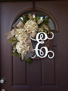 Picture#4 shows script alphabet (12)  Picture #5 shows curly alphabet ( 8) The style shown on the picture is 12 ivory script.   A beautiful ,year-round wreath decorated with 3 cream hydrangea blossoms,hydrangea and peony leaves and cream flock spray,complemented by overlapping burlap bows : chevron black with natural underneath , topped with plain burlap. Made on 18  grapevine wreath base,finished wreath measures approximately 20 -21in diameter and is about 6  deep   This lovely wreath…