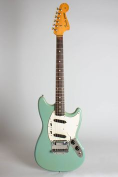 Fender Mustang Model Solid Body Electric Guitar (1965), made in Fullerton, California, serial # L64089, Daphne Blue lacquer finish, alder body, maple neck with rosewood fingerboard, original grey hard shell case. This is a super attractive and extremely well-preserved Fender Mustang, made in ear...