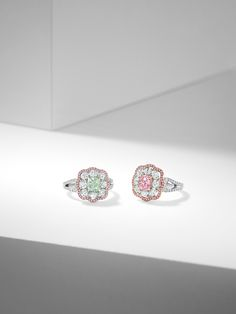 Fancy Coloured Diamonds: The simple beauty of diamonds takes on a different complexion when the stones in question are coloured. Fancy coloured diamonds have always been an important part of Boodles repertoire. Our designers enjoy playing with different combinations to delight and dazzle in equal measure. A fancy yellowish green cushion cut diamond in a vintage style ring and a matching one with a pink-purple central diamond. Both with a pink diamond halo.