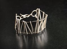 This linear inspired bracelet is made of all sterling silver from forged square wire, it is sure to capture attention Handcrafted Jewelry, Handmade, Flower Pendant, Sterling Silver Chains, Jewelry Design, Hoop Earrings, Hair Accessories, Detail, Bracelets