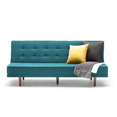 """Turquoise Sleeper Sofa   dotandbo.com Hahaha! I had a sofa that looked exactly like this in 1974. Crazy! Oh...and it did NOT cost $1300. I called it my """"early attic"""" look, back then!"""