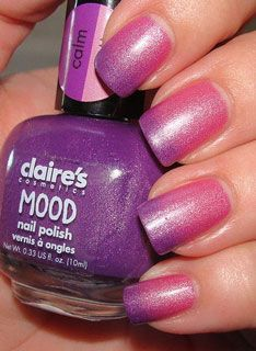 Claire's Mood Nail Polish.  The jury is still out...Calm/Wild ($5) is purple with lots of silver shimmer when cool and a pretty, springy pink when warm.  Seems too thin and dries with streaks and a very dull finish so it needs shiny top coat.