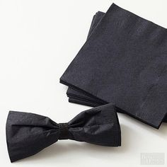 Tuxedo Inspired Table Decor — make your bow tie out of a paper napkin! That's what the folks at Better Homes and Gardens did. You could even get the kids involved because they've included very simple instructions that are easy to follow. #bowtie #napkinfolding #tabledecor