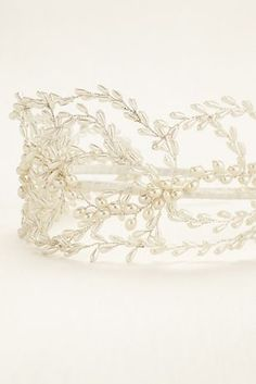 Sweep back your locks in a boho chic style with this stunning pearl headband!  This beautiful headband features exquisite pearls in a woven vine pattern for a classic look with a bohemian touch.  Imported.