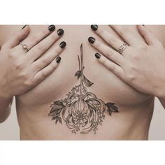 floral underboob tattoo by tritoan ly (really like this like youre drying flowers or herbs)