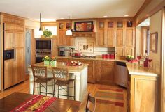 Oak cabinets mission kitchen. Would change some things, but it's a good concept.