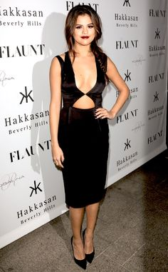 Selena Gomez flashes her cleavage in a provocative, plunging LBD by Cushnie et Ochs. #fashion