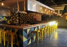 Trending Industrial with Nando's Central Kitchen and Cemcrete cement-based floors