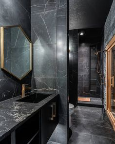 It doesn't get more luxurious than this! Our Marmi Classico Porcelain is an affordable option to achieve the look of a black marble.  Design by @aprilzford. Photo by @mirzakudic. Build by @kimberleydevelopment. Tile displayed: Marmi Classico Nero Venato Silk Porcelain. Bathroom Tile Designs, Bathroom Trends, Bathroom Interior Design, Bertch Cabinets, Dark Bathrooms, Tile Wallpaper, The Tile Shop, Black Marble, Bathroom Inspiration