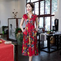Fabric: Polyester Length: Tea-length Silhouette: A-line Neck: V Neck Pattern: Floral Sleeve: Cap Sleeve Floral Sleeve, Neck Pattern, Cheongsam, Tea Length, Chinese Style, V Neck Tops, Pleated Skirt, Cap Sleeves, Chinese Dresses