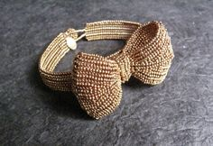 seed bead bracelet.....I'd like to try making this with stretchy thread and as a headband :)