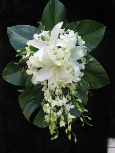 White oriental lilies and white Singapore orchids make the perfect summer bouqet.