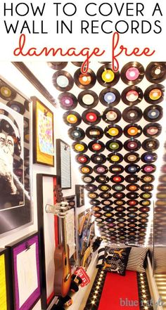 RECORD FEATURE WALL! Cover a ceiling or wall in vinyl records makes a major statement in a music room or playroom! Learn how to hang the records completely damage free.