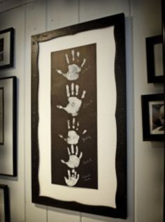 Handprints Daddy, Mommy,and Alivia... love this for her playroom!!