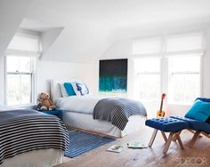 A cute, simply designed children's bedroom in a contemporary Nantucket Retreat.