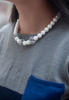 """A gleaming faux glasses and geometric metals on this on-trend collar necklace perfect for adding a little throwback style into your ensemble.  Length: 17"""" Extender: 2 1/2"""" Lobster clasp closure Weight: 35g Faux pearls / metal / Silver plated"""