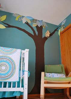 cute baby room idea, family tree with family photos hanging off branches