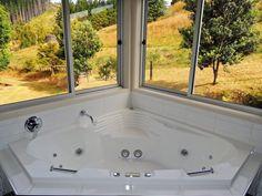 Woodyhanger Lodge bathroom - spa bath with a view