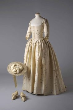 Silk brocade gown and petticoat, silk covered straw hat and silk satin shoes, 1780 Worn by Jane Bailey for her marriage to James Wickham Image reproduced by kind permission of the Olive Matthews Collection, Chertsey Museum.   Photograph by John Chase.