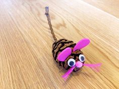 Create a cute little mouse friend out of a pine cone.
