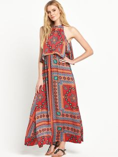 Add a touch of bohemian charm to your summer wardrobe with this double layered maxi dress from V by Very. Its two-part design creates the illusion of a cute co-ord, while the light and breezy fabric keeps you cool in sweltering climes. Adorned with an all-over print in an earthy colour palette, it's perfect for summers spent in the city or at festivals. Styling Ideas This effortless piece needs just a pair of simple flat sandals and an oversizedslouchy ba...