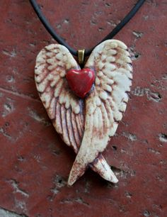 Rustic Red Heart Porcelain Winged Pendant 1 by muddyfingers Polymer Clay Pendant, Polymer Clay Crafts, Diy Clay, Polymer Clay Jewelry, Ceramic Jewelry, Ceramic Art, Ceramic Bowls, Heart With Wings, Clay Ornaments