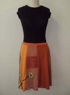 Upcycled, recycled, appliqué orange t-shirt skirt with flowers