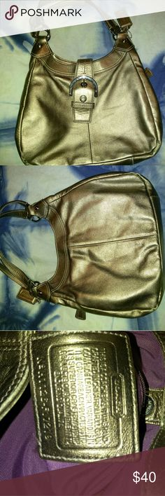 Coach shoulder bag Bronze or Copper color Used Coach bag pics look gold but it's more a Copper shade. There is little wear on the bottom corners. I tried to show it in the pics. Handles have wear and only one tiny spot on bag also shown in pics. The inside is clean like brand new and the bag looks like it's brand new too! Make an offer also would trade. Thanks for looking! Coach Bags Shoulder Bags