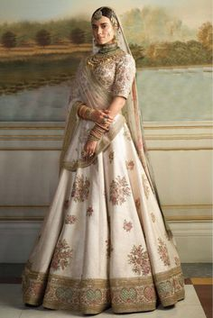 The Stylish And Elegant Lehenag Choli In Cream Colour Looks Stunning And Gorgeous With Trendy And Fashionable Embroidery . The Silk Fabric Party Wear Lehenga Choli Looks Extremely Attractive And Can A. Indian Bridal Lehenga, Indian Bridal Outfits, Indian Bridal Wear, Indian Designer Outfits, Bridal Dresses, Sabyasachi Lehenga Bridal, Banarasi Lehenga, Designer Bridal Lehenga, Designer Dresses