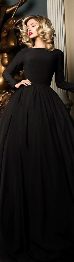evening gown with sleeves Yulia Prokhorova New Year 2016. Love the beautiful black dress even more with the luscious red lipstick.