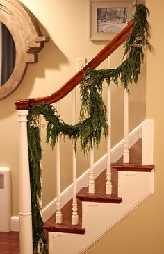 Hang garlands on the staircase as a rustic decor look