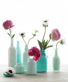 Two of my favorite flowers: peonies and poppies. The vintage-y vases with milky look make the colors pop! #flowerarrangements