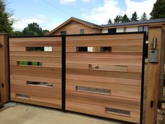 Modern design. Wood clad steel swing gates