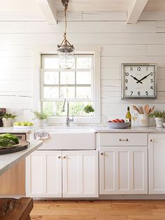 We'd love to have the chance to cook in this bright, airy kitchen! Aged metals, like the polished nickel frame of this clock, give edge to neutral rooms.