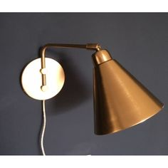 Game Wall Lamp by House Doctor DK. A game changer of a light from House Doctor, this mighty fine piece of brass illumination hits the sweet spot of timeless yet contemporary making it an apt choice for any well considered setting.