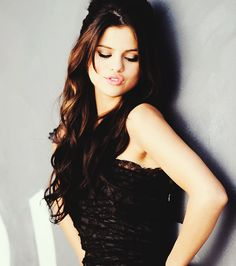 long brown hair, and beautiful makeup (selena gomez)