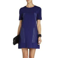 BCBG MaxAzria Dress BCBG MaxAzria faux-leather shift dress.  Mid length Heavy knit - nylon, polyester and 8% spandex.  New without tags.  Size S. BCBGMaxAzria Dresses Midi