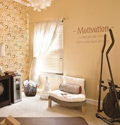 "I'd like to make a corner like this where my eliptical machine is   ""Motivation"" quote for workout room.  A peach colored room with a yoga mat, fan, and eliptical machine. One of the walls has a motivational message. And a chair to rest afterward!"