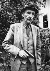 William Burroughs in a Suit Holding a Gun