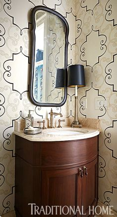 Wallpaper with a large-scale pattern works beautifully in this small powder room. - Photo: Werner Straube / Design: Margaret Neal