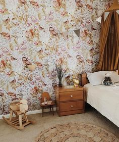 "Fleur Harris ""Woodlands"" floral wallpaper with owls, rabbits and squirrels, gold Numero 74 canopy, kids room, little girl's room. Gold rabbit lamp. Rocking horse."
