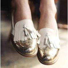 Gold and white fringed shoes