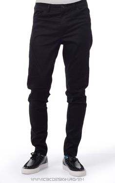 """: Long pants from stretch canvas fabric with front and back pockets, waistband with belt loops and button closure. Relaxed fit, slim leg, medium rise. The sharp insertions on the front and sides are defined by the exposed stitching, together with the matte smooth fabric they give off an urban """"office"""" feel. They are a versatile item, suitable for the office: worn with a sharp shirt and oxford shoes. For casual meetings wear them turned up, with a warm pullover and boots."""