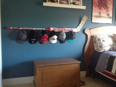 My son needed somewhere to store his hats, so I used this old hockey goalie stick and some Command Strip hooks (smaller hooks for the hats, and larger plastic hooks to hang the stick to the wall).