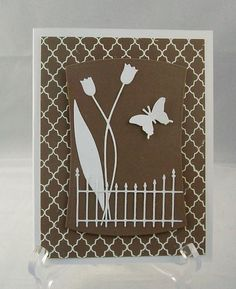 Die-cut Birthday by judkajudy, via Flickr  dancing tulips, MS butterfly punch and rounded fence..tassatina border?