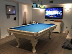 "Shoot pool on this one of a kind 8ft Brunswick pool table.  Custom painted in white with grey distressing and covered in tournament blue simonis cloth.  Perfect for this oceanfront penthouse in North Myrtle Beach!  Come on!  You know you want to play on this table while watching your favorite sports team on this 60"" HDTV White Pool Table, Brunswick Pool Tables, North Myrtle Beach, Custom Paint, Game Room, Grey And White, Playroom, Bedroom Ideas, Condo"