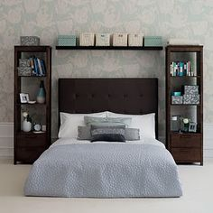 For master bedroom: vertical cases on both sides of the bed, and a shelf above.