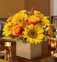 Celebrate the magic of fall with this arrangement of bi-color #roses and #sunflowers!