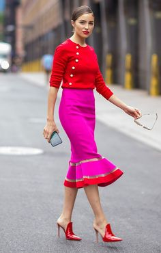 Olivia Culpo in a red sweater and pink pencil skirt